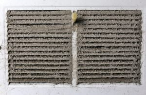 Air duct cleaning services for clogged air vent.